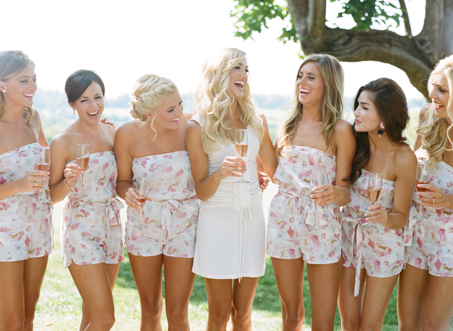 bride and bridesmaids wearing plum pretty sugar rompers